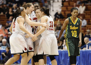 Photo - Louisville's Tia Gibbs, left, Sara Hammond, second from left, Asia Taylor, back center, Jude Schimmel and Shoni Schimmel (23) celebrate as South Florida's Courtney Williams, right, looks on after Louisville broke a tie in the final seconds of an NCAA college basketball game in the semifinals of the American Athletic Conference women's tournament on Sunday, March 9, 2014, in Uncasville, Conn. Louisville won 60-56. (AP Photo/Jessica Hill)