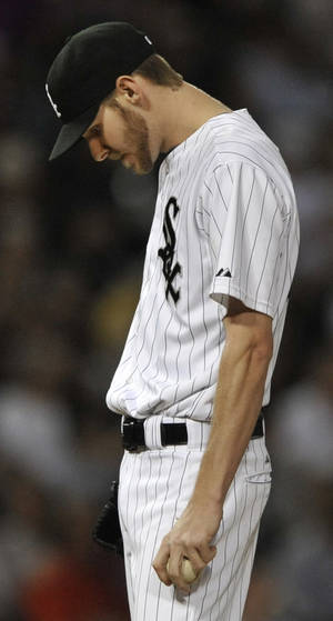 Photo - Chicago White Sox starting pitcher Chris Sale reacts to giving up an inside-the-park home run to Texas Rangers' Ian Kinsler during the third inning of a baseball game in Chicago, Friday, Aug. 23, 2013. (AP Photo/Paul Beaty)