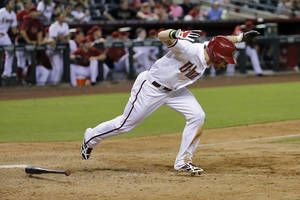 Photo - Arizona Diamondbacks' Ender Inciarte reacts to his RBI single  during the 11th inning of a baseball game against the Cleveland Indians, Tuesday, June 24, 2014, in Phoenix. (AP Photo/Matt York)