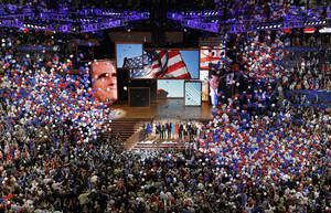 Photo -   Republican presidential nominee Mitt Romney and vice presidential nominee Rep. Paul Ryan are join on the stage by their families at the end of the Republican National Convention in Tampa, Fla., on Thursday, Aug. 30, 2012. (AP Photo/Patrick Semansky)
