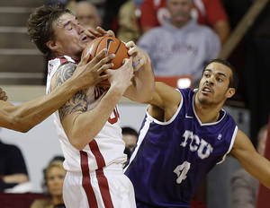 Photo - Oklahoma's Ryan Spangler grabs a rebound beside TCU's Amric Fields (4) during an NCAA college basketball game between the University of Oklahoma (OU) and Texas Christian University (TCU) at Lloyd Noble Center, Wednesday, Jan. 22, 2014.  Oklahoma won 77-69. Photo by Bryan Terry, The Oklahoman