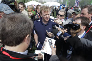 Photo -   NFL Commissioner Roger Goodell, center, is surrounded by reporters during the NFL Play 60 Youth Football Festival, Wednesday, April 25, 2012, in New York. (AP Photo/Mary Altaffer)