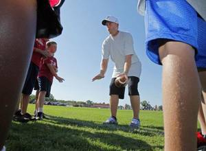 photo - Jason White gives pointers at Adrian Peterson Football Camp on Thursday, June 23, 2011, in Norman, Okla. Photo by Steve Sisney, The Oklahoman <strong>STEVE SISNEY</strong>