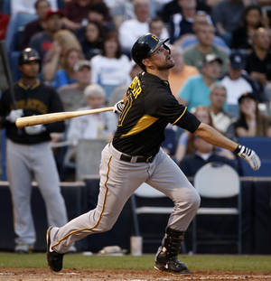 Photo - Pittsburgh Pirates Jordy Mercer hits a single to center field during the second inning of in a spring exhibition baseball game agains the New York Yankees in Tampa, Fla., Friday, March 21, 2014.  (AP Photo/Kathy Willens)