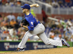 Photo - New York Mets' Zack Wheeler pitches to the Miami Marlins in the fifth inning of a baseball game in Miami, Wednesday, May 7, 2014. (AP Photo/Alan Diaz)