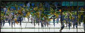 Photo - Echoes of nature: The transoms on the south side of the dining room were leaded glass windows depicting wisteria falling over the eaves. The glass panels echoed the live wisteria that grew just beyond the window. Photo courtesy Morse Museum.   <strong></strong>