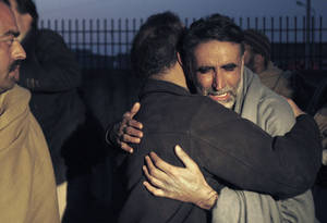 photo - A father of an aid worker, who was killed by gunmen, mourns the death of his daughter at a hospital in Swabi, Pakistan, Tuesday, Jan. 1, 2013. Gunmen in northwest Pakistan killed at least five female teachers and two aid workers on Tuesday in an ambush on a van carrying workers home from their jobs at a community center, officials said. (AP Photo/Mohammad Sajjad)