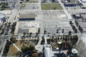 photo - This photo looking south from Devon Tower shows the proposed site for the MAPS 3 convention center south of Myriad Gardens and west of Chesapeake Energy Arena. City officials hope to purchase the property, an old Ford dealership, in 2013, and advance the design process.