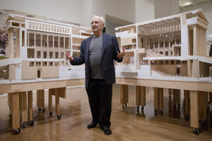 Photo - Architect Frank Gehry poses for photographs in front of a model that helps illustrate the Philadelphia Museum of Art's master plan, on Thursday, June 26, 2014, in Philadelphia. A massive renovation designed by Gehry is planned for the Philadelphia Museum of Art that will result in little change to the building's Greek revival facade but a major expansion of gallery space. (AP Photo/Matt Rourke)
