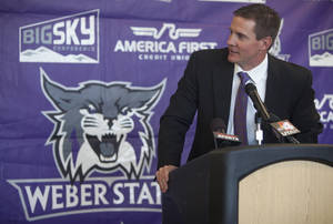 Photo - Jay Hill speaks with reporters at a press conference where he was introduced as the new head NCAA college football coach at Weber State University, Thursday, Dec. 12, 2013 in Ogden, Utah. (AP Photo/Standard-Examiner, Benjamin Zack) TV OUT; MANDATORY CREDIT