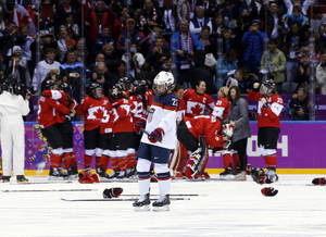 Photo - Michelle Picard of the United States (23) skates back to the bench after Canada scored in overtime to win the women's gold medal ice hockey game 3-2 at the 2014 Winter Olympics, Thursday, Feb. 20, 2014, in Sochi, Russia. (AP Photo/Matt Slocum)