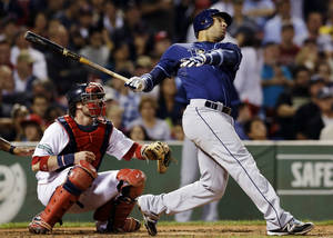 photo - FILE - This Sept. 26, 2012 file photo shows Tampa Bay Rays' Carlos Pena following through on a two-run home run as Boston Red Sox catcher Jarrod Saltalamacchia watches in the fifth inning of a baseball game at Fenway Park in Boston. The Houston Astros have signed veteran Carlos Pena to be their designated hitter, addressing a key need as they prepare for their first season in the American League. (AP Photo/Elise Amendola, File)