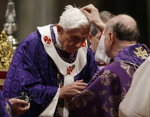 "Photo - Cardinal  Angelo Comastri puts ash on Pope Benedict XVI's head during the celebration of Ash Wednesday mass in St. Peter's Basilica at the Vatican, Wednesday, Feb. 13, 2013.  Ash Wednesday marks the beginning of Lent, a solemn period of 40 days of prayer and self-denial leading up to Easter. Pope Benedict XVI told thousands of faithful Wednesday that he was resigning for ""the good of the church"", an extraordinary scene of a pope explaining himself to his flock that unfolded in his first appearance since dropping the bombshell announcement. (AP Photo/Gregorio Borgia)"