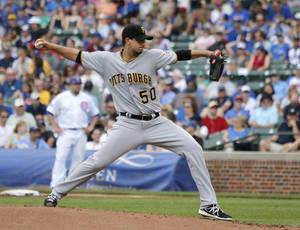 Photo - Pittsburgh Pirates starting pitcher Charlie Morton delivers during the first inning of a baseball game against the Chicago Cubs, Friday, June 20, 2014, in Chicago. (AP Photo/Charles Rex Arbogast)