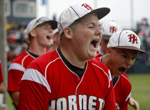 Photo - Hilldale celebrates during the 4A high school baseball playoff game between Hilldale and Anadarko at Shawnee High School in Shawnee, Okla., Friday, May 11, 2012. Photo by Sarah Phipps, The Oklahoman