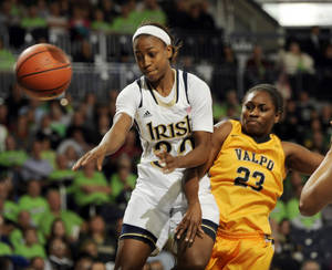 Photo - Notre Dame guard Jewell Loyd, left, drives the lane as Valparaiso guard Charae Richardson slaps the ball away during the first half of an NCAA college basketball game Saturday, Nov. 16, 2013, in South Bend, Ind.  (AP Photo/Joe Raymond)