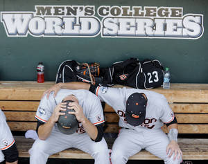 Photo - Oregon State's Matt Boyd, left, and Nate Esposito sit in the dugout after losing 4-1 to Mississippi State in an NCAA College World Series baseball game in Omaha, Neb., Friday, June 21, 2013. Mississippi State advances to the championship series and Oregon State is eliminated. (AP Photo/Francis Gardler)