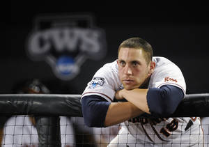 Photo - Virginia catcher Nate Irving watches as Vanderbilt players celebrate after Vanderbilt defeated Virginia 3-2 in the deciding game of the best-of-three NCAA baseball College World Series finals in Omaha, Neb., Wednesday, June 25, 2014. (AP Photo/Eric Francis)