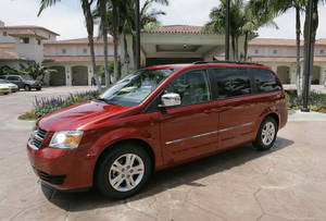 "Photo - FILE - This July 17, 2007 file photo shows the 2008 Dodge Grand Caravan at the Four Seasons Hotel in Carlsbad, Calif. On Wednesday, June 18, 2014, the National Highway Traffic Safety Administration posted documents on its website detailing an investigation of about 700,000 Dodge Journey SUVs and Chrysler Town and Country and Dodge Grand Caravan minivans from the 2008 to 2010 model years. The agency wants to see if the keys can fall out of the run position under ""harsh roadway conditions."" (AP Photo/Lenny Ignelzi, File)"