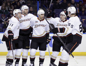 Photo - Anaheim Ducks' Andrew Cogliano (7), center, is congratulated by teammates after scoring a goal in the first period of an NHL hockey game against the St. Louis Blues, Saturday, Dec. 7, 2013, in St. Louis. (AP Photo/Tom Gannam)
