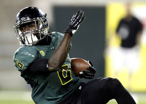 Photo -   Oregon running back De'Anthony turns upfield during the first half of their NCAA college football game against Arizona in Eugene, Ore., Saturday, Sept. 22, 2012. (AP Photo/Don Ryan)