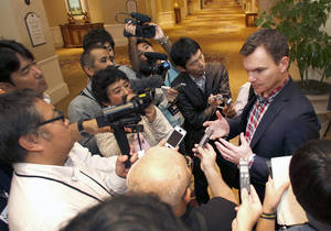 Photo - Boston Red Sox general manager Ben Cherington talks with the media at the annual baseball general managers meeting, Tuesday, Nov. 12, 2013, in Orlando, Fla. (AP Photo/Reinhold Matay)