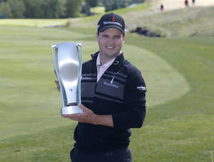 Photo - Zach Johnson poses with the BMW Championship trophy after winning the BMW Championship golf tournament at Conway Farms Golf Club in Lake Forest, Ill., Monday, Sept. 16, 2013. (AP Photo/Charles Rex Arbogast)