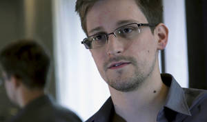Photo - FILE - In this Sunday, June 9, 2013 file photo provided by The Guardian newspaper in London, shows Edward Snowden, who worked as a contract employee at the U.S. National Security Agency, in Hong Kong. Two Norwegian lawmakers said Wednesday, Jan. 29, 2014 that they have jointly nominated former NSA contractor Edward Snowden for the 2014 Nobel Peace Prize. (AP Photo/The Guardian, File)