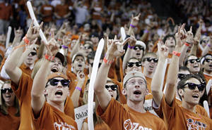 Photo - Longhorn fans sing 'The Eyes of Texas' before the college basketball game between the Oklahoma State University Cowboys and the University of Texas Longhorns at the Frank C. Erwin, Jr., Special Events Center on Monday, Feb. 12, 2007, in Austin, Texas. Photo by CHRIS LANDSBERGER, The Oklahoman