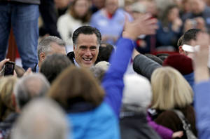 Photo -   Republican presidential candidate, former Massachusetts Gov. Mitt Romney greets supporters at a campaign event at Portsmouth International Airport before departing for Iowa, Saturday, Nov. 3, 2012, in Newington, N.H. (AP Photo/David Goldman)