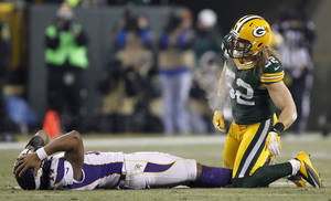 photo - Minnesota Vikings quarterback Joe Webb (14) reacts after throwing an incmplete pass and getting hit by Green Bay Packers outside linebacker Clay Matthews (52) during the second half of an NFL wild card playoff football game Saturday, Jan. 5, 2013, in Green Bay, Wis. (AP Photo/Mike Roemer)