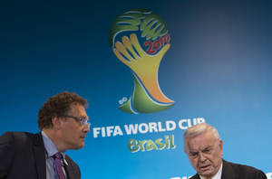 Photo - FIFA Secretary General Jerome Valcke, left, and President of Brazilian Soccer Confederation Jose Maria Marin arrive for a news conference at the Maracana stadium in Rio de Janeiro, Brazil, Thursday, March 27, 2014. (AP Photo/Felipe Dana)