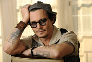 """Photo -   FILE - In this Oct. 12, 2011 file photo, Johnny Depp, a cast member in the film """"The Rum Diary,"""" poses for a portrait in Beverly Hills, Calif. In San Diego, fans at Comic-Con on Thursday, July 12, 2012, got the first look at """"The Lone Ranger,"""" which stars Depp, set for release next summer. (AP Photo/Chris Pizzello, File)"""