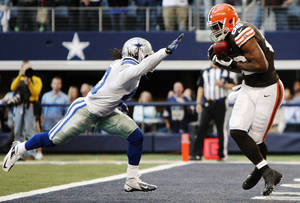 Photo -   Dallas Cowboys strong safety Danny McCray (40) is unable to stop Cleveland Browns tight end Benjamin Watson (82) from grabbing a pass for a touchdown late in the second half of an NFL football game, Sunday, Nov. 18, 2012, in Arlington, Texas. (AP Photo/Brandon Wade)