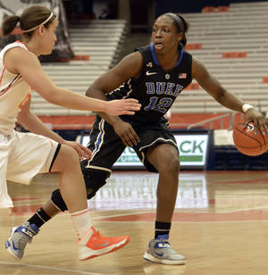 Photo - Duke's Chelsea Gray, right, brings the ball up court against Syracuse's Brianna Butler during the first half of an NCAA college basketball game in Syracuse, N.Y., Thursday, Jan. 9, 2014. (AP Photo/Kevin Rivoli)