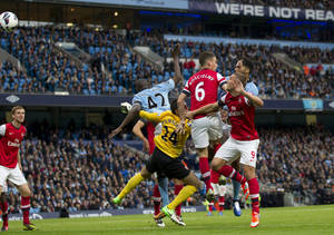 Photo -   Manchester City's Joleon Lescott, rear right, scores against Arsenal during their English Premier League soccer match at The Etihad Stadium, Manchester, England, Sunday, Sept. 23, 2012. (AP Photo/Jon Super)