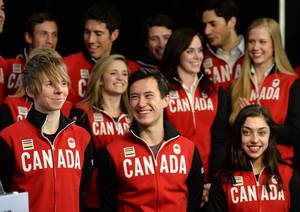 Photo - Figure skaters, bottom row from left to right, Kevin Reynolds of Coquitlam, Patrick Chan, and Gabrielle Daleman are joined by teammates during the announcement of the Canadian Olympic Team in Ottawa, Ontario, Sunday, Jan. 12, 2014. The skaters are to represent Canada in Sochi. (AP Photo/The Canadian Press, Sean Kilpatrick)