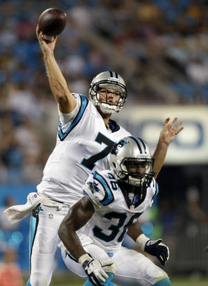 Photo - Carolina Panthers' Jimmy Clausen (7) throws a pass against the Pittsburgh Steelers during the second half of an NFL preseason football game in Charlotte, N.C., Thursday, Aug. 29, 2013. The Panthers won 25-10. (AP Photo/Bob Leverone)