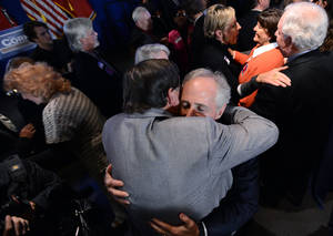 Photo -   Sen. Bob Corker, R-Tenn., is greeted by several of his supporters after speaking at his election night victory rally at the Cabana Restaurant on Tuesday, Nov. 6, 2012, in Nashville, Tenn. (AP Photo/Mark Zaleski)