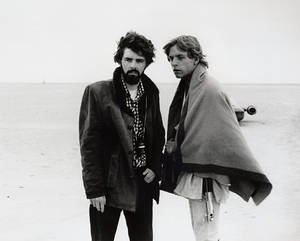 "Photo -   In this March 1976 publicity photo released by Lucasfilm Ltd. & TM, director, George Lucas, and actor, Mark Hamill, who portrays young Luke Skywalker, are shown on the salt flats of Tunisia during principal photography of the original ""Star Wars."" There's no mistaking the similarities. A childhood on a dusty farm, a love of fast vehicles, a rebel who battles an overpowering empire, George Lucas is the hero he created, Luke Skywalker. (AP Photo/Lucasfilm Ltd. & TM)"