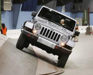 Photo - Erin O'Connor drives a Jeep Wrangler through the obstacle course of Camp Jeep at the Oklahoma City International Auto Show at State Fair Park. Photo by Steve Gooch, The Oklahoman