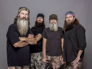 "Photo - This 2012 photo released by A&E shows, from left, Phil Robertson, Jase Robertson, Si Robertson and Willie Robertson from the A&E series, ""Duck Dynasty,"" airing Wednesdays at 10 p.m. EST. (AP Photo/A&E, Zach Dilgard)"