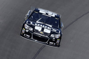 Photo - NASCAR Sprint Cup series driver Jimmie Johnson practices in his backup car for the Pure Michigan 400 auto race at Michigan International Speedway in Brooklyn, Mich., Saturday, Aug. 17, 2013. (AP Photo/Paul Sancya)