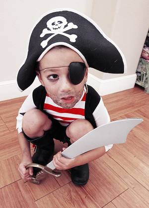 "Photo - Jay Paradis, 3, Edmond, dressed like a pirate while attending the ""Ahoy Matey"" class for pre-schoolers during International Talk Like a Pirate Day. PHOTO BY PAUL B. SOUTHERLAND, THE OKLAHOMAN. <strong>PAUL B. SOUTHERLAND - THE OKLAHOMAN</strong>"