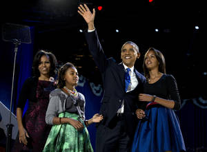 Photo -   President Barack Obama waves as he walks on stage with first lady Michelle Obama and daughters Malia and Sasha at his election night party Wednesday, Nov. 7, 2012, in Chicago. Obama defeated Republican challenger former Massachusetts Gov. Mitt Romney. (AP Photo/Carolyn Kaster)