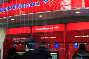 Photo -   In this Jan. 31, 2011 photo, Bank of America customers use ATM machines in New York. Truly free checking accounts are becoming rarer as banks add more fees to boost their profits. Financial data publisher Bankrate.com says a survey shows only 39 percent of non-interest checking accounts are free to all customers. That's down from 45 percent last year and 76 percent in 2009. (AP Photo/Mark Lennihan)