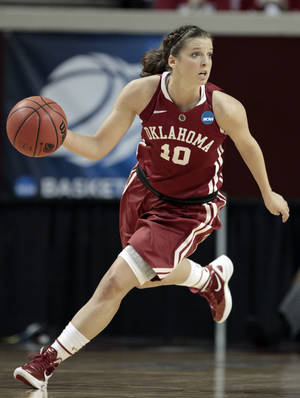 photo - NCAA WOMEN'S COLLEGE BASKETBALL TOURNAMENT: Oklahoma Sooners' Morgan Hook (10) dribbles up the court as the University of Oklahoma Sooners (OU) play the St. John's Red Storm in the second round of the NCAA Women's Basketball Championship Tournament at the Lloyd Noble Center on Tuesday, March 20, 2012, in Norman, Okla.   Photo by Steve Sisney, The Oklahoman