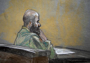 Photo - In this courtroom sketch, U.S. Army Maj. Nidal Malik Hasan is shown during closing arguments of his court martial,  Thursday Aug. 22, 2013, in Fort Hood, Texas. (AP Photo/Brigitte Woosley)