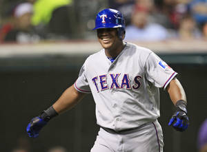 Photo -   Texas Rangers' Adrian Beltre smiles after scoring on a single by Michael Young in the seventh inning of a baseball game against the Cleveland Indians, Friday, Aug. 31, 2012, in Cleveland. (AP Photo/Tony Dejak)