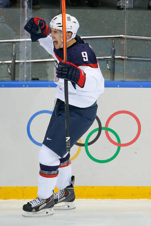 Photo - USA forward Zach Parise celebrates his goal against the Czech Republic during the second period of men's quarterfinal hockey game in Shayba Arena at the 2014 Winter Olympics, Wednesday, Feb. 19, 2014, in Sochi, Russia. (AP Photo/Matt Slocum)
